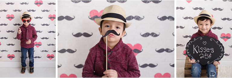 Valentine mini photo session mustache backdrop boy wearing hat kisses sign